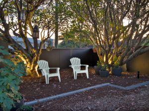 art deco queenslander relaxing under trees at dusk