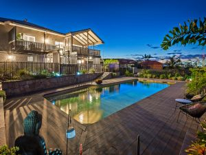 art deco queenslander renovation pool area and house at night