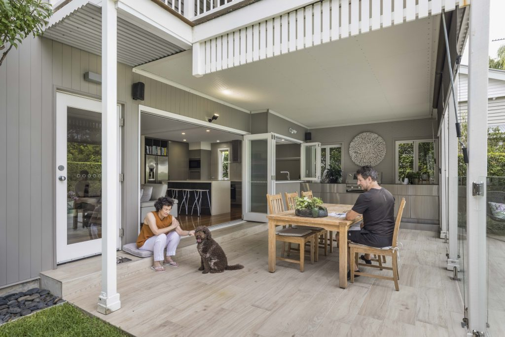 image of couple sitting outside their renovated hawthorne queenslander